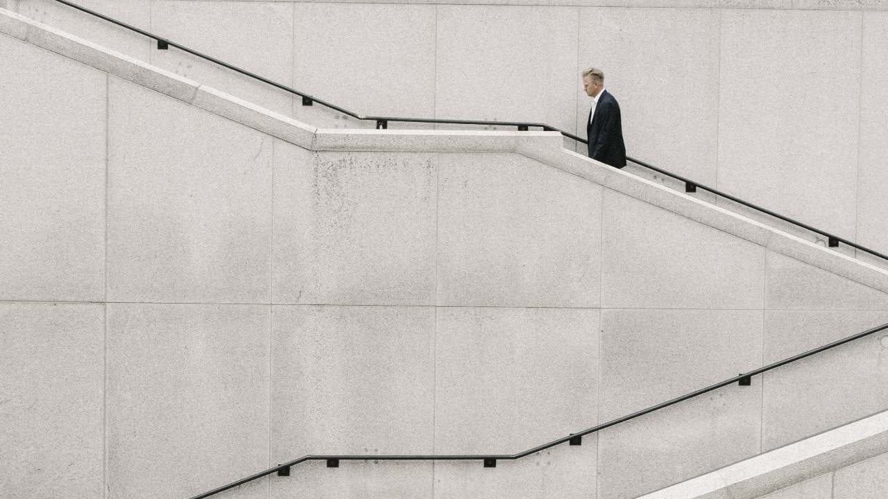 Distance view of an office person climbing stairs